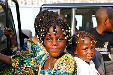 Two girls with elaborate braids in their hair, Cameroon, Africa