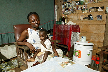 HIV-infected mother and her child in the living room, Cameroon, Africa