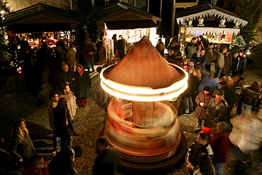 Children's carousel, Christmas market, Muehldorf am Inn, Upper Bavaria, Bavaria, Germany, Europe