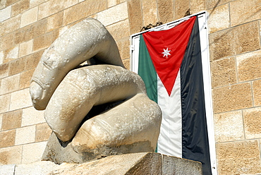 Fingers of the Statue of Hercules and the Jordanian Flag in front of the Archaeological Museum, Jebel al-Qala, Amman, Jordan