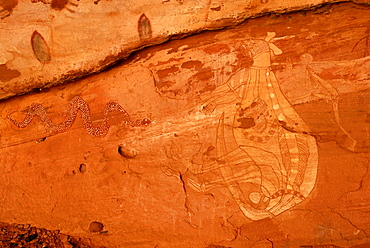 Old rock art of the Aborigines, hunting Kangaroos with a spear, south of Alice Springs, Northern Territory, Australia