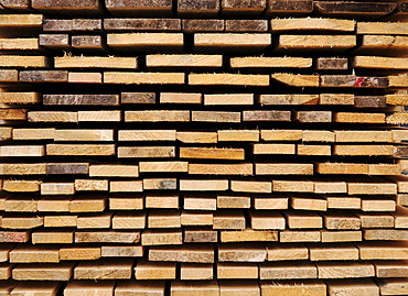 Stacked wooden boards, building material, view of the ends, image-filling
