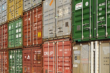 Sloping view of stacked overseas containers, format-filling