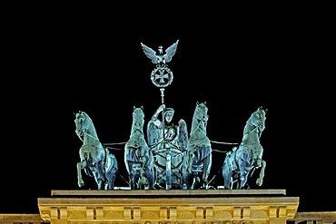 Illuminated quadriga on brandenburg gate in berlin during festival of lights, berlin, germany
