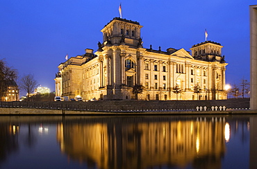 Reichstag, German parliament building reflected in the Spree River in the evening, Berlin, Germany