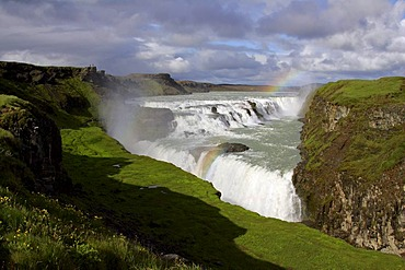 Gullfoss-Waterfall at the Hvita-River near by the Langjoekull-Glacier in Iceland with rainbow in the evening light Golden Waterfall Iceland