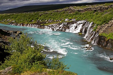 Hvita-River with Hraunfossar-Waterfalls (Lava-Waterfalls) at the right side near by the Langjoekull-Glacier in Iceland