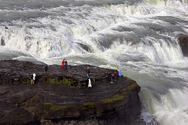 Tourists at Gullfoss-waterfall at the Hvita-river in Iceland - Iceland, Europe