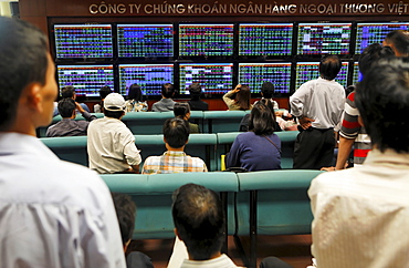 Stock trading at Vietcombank Securities, retail banking customers watch the stock prices on monitors, Hanoi, Vietnam, Asia