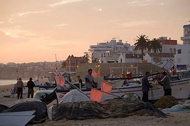 Fishermen and their boats on Praia do Armacao de Pera, Algarve, Portugal, Europe
