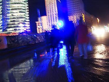 People at night at the Potsdamer square, Berlin, Germany