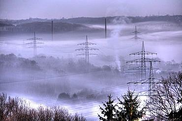 DEU Germany Bochum : High Voltage electrical power lines between Essen Bochum morning fog.  
