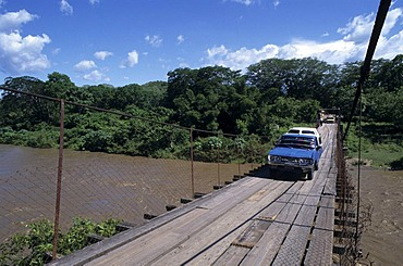 Suspension bridge above the Rio Chamelecon, Copan province, Honduras