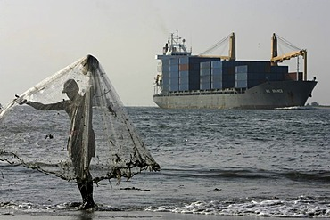 Net fisching and container ship, Fort Cochin, Kerala, India