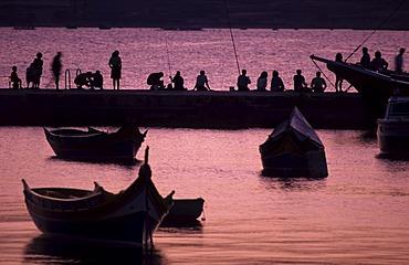 St. Paul's Bay, angler at the jetty, St. Paul's Bay, Malta