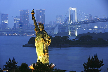 View from Odaiba over Bay with Rainbow-Bridge to mainland Odaiba is an artificial island in Bay conected to the mainland by Rainbow-Bridge Modern district with hotels shopping malls museums restaurants Headquarter of Fuji TV Replica of Statue of Liberty T