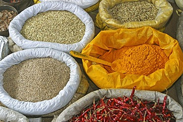 Rice, saffron, chilies in bags at the market in Chatra, Westbengalia, India