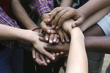 Indian and German hands on top of each other in friendship