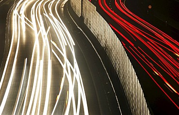 DEU, Germany : Essen, motorway Autobahn A52. Rushhour in the evening. Noise protection wall.