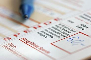 DEU, Germany : bank transfer form for a donation to a voluntary organization. Symbolic photo economy