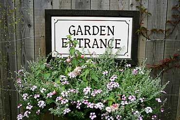"Sign on wooden wall ""Garden Entrance"", The Lost Gardens of Heligan, Pentewan, St. Austell, Cornwall, Great Britain"