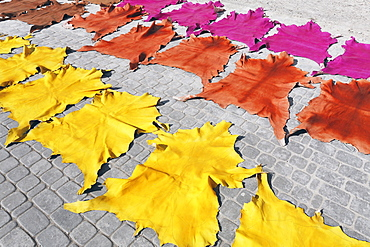 Tanned and dyed animal skins, spread out on the pavement for drying, historic Medina quarter, Marrakesh, Morocco, Africa