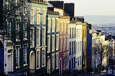 Row of houses in a steep street, pastel coloured facades, Cork, Ireland, Europe