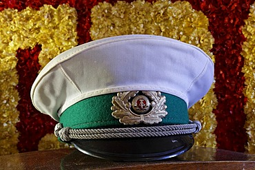 Policehat with East German insignia as decoration in the ostalgie tavern Zur Molle, Seebad Bansin, Usedom Island, Mecklenburg-Western Pomerania, Germany, Europe