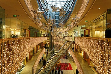 Hall of a multistoried modern department store decorated for christmas, stilwerk, duesseldorf, germany