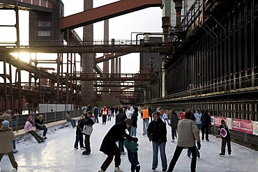 Ice-skating in front of the disused coking plant Zollverein, Essen, NRW, Germany