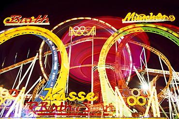 Amusement rides at Oktoberfest (Octoberfest Munich Beer Festival), Munich, Germany, Europe