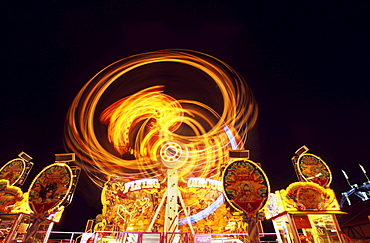 Amusement rides at Oktoberfest (Octoberfest Munich Beer Festival), Munich, Germany, Europe