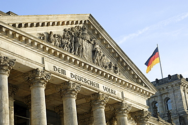 Reichstag (German parliament building) and German flag, Berlin, Germany