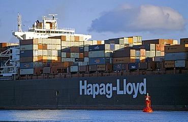 Huge container ship of shipping company Hapag Lloyd on river Elbe at Hamburg Germany