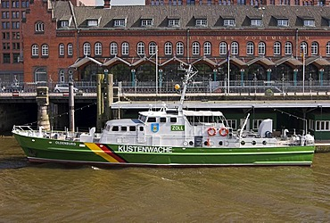 Customs boat Oldenburg in front of the German Customs Museum in the old warehouse district Speicherstadt at Hamburg Harbour, Hamburg, Germany