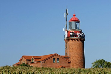 Tourists enjoying the view from the old lighthouse in Bastorf near Kuehlungsborn, Western-Pomerania, Germany