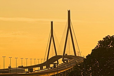 Koehlbrandbruecke at river Suederelbe at sunset, Hamburg, Germany