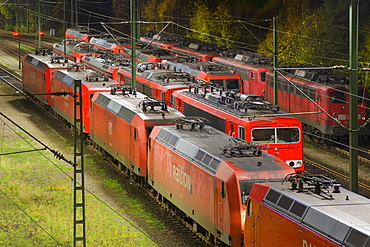 Parked electric locomotives at Maschen railroad shunting yard near Hamburg at night, Lower Saxony, Germany