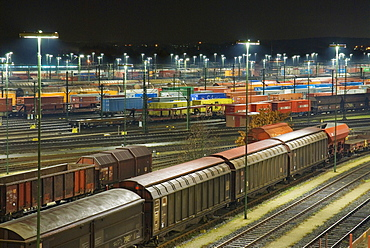 Parked freight trains at Maschen railroad shunting yard near Hamburg at night, Lower Saxony, Germany