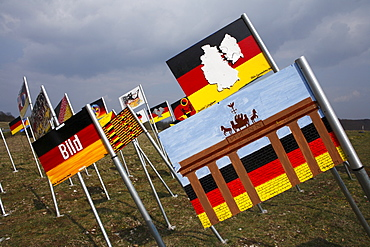 """Field of flags, """"Sculpture park"""" national monument to German unity on the Thuringian/Bavarian border near to Henneberg, Rhoen-Grabfeld, Lower Franconia, Bavaria, Germany, Europe"""