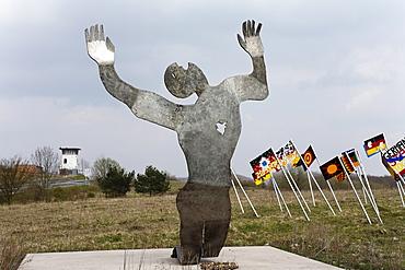 """Shot whilst fleeing"" by Herbert Fell, ""Sculpture park"" national monument to German unity on the Thuringian/Bavarian border near to Henneberg, Rhoen-Grabfeld, Lower Franconia, Bavaria, Germany, Europe"