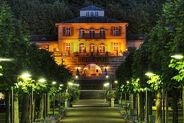 Kurpark state baths in Brueckenau, view toward Hotel Restaurant Bellevue, night shot, Bad Brueckenau, Rhoen Mountains, Lower Franconia, Bavaria, Germany, Europe