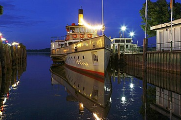 "Night-time illuminated pleasure paddle steamer ""Ludwig Fessler"" in Prien harbour, Lake Chiemsee, Chiemgau, Upper Bavaria, Germany, Europe"