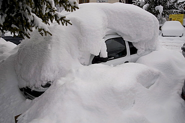 Car buried under a pile of snow, Arabba, Bolzano-Bozen, Dolomites, Italy, Europe