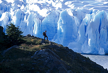 Hiker in front of the edge of Gray Glacier, Torres del Paine National Park, Patagonia, Chile, South America
