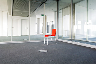 Red empty chair in a room