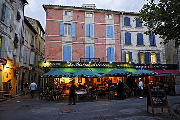 External evening view of a bistro on the Place Du Forum in Arles, Provence, France