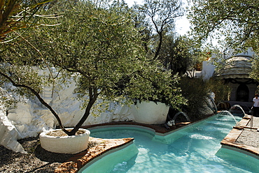 Phallus-shaped, phallic swimming pool in the garden at the former home of surrealist painter Salvador Dali and his wife Gala in Port Lligat, Province Girona, Spain