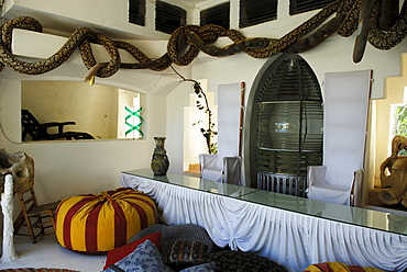 Throne chairs and an old lighthouse lamp dominate dining area at the head of the swimming pool at the former home of surrealist painter Salvador Dali and his wife Gala in Port Lligat, Province Girona, Spain