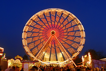 A big wheel on a annual fair - Baden Wuerttemberg Germany Europe.